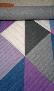 Close up of Fading to Grey while it is still in the quilting frame.